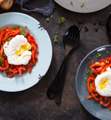Stewed pointed peppers with poached egg